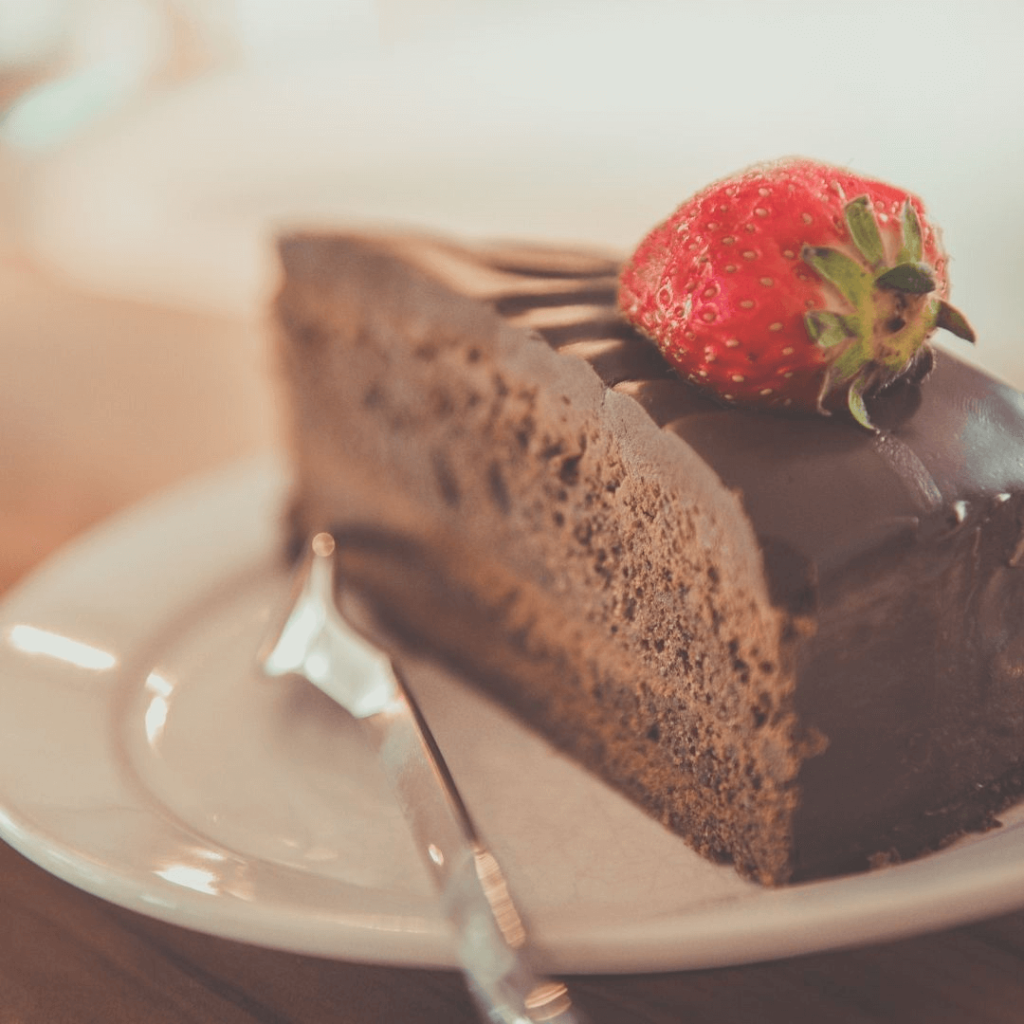 chocolate cake with strawberries on top