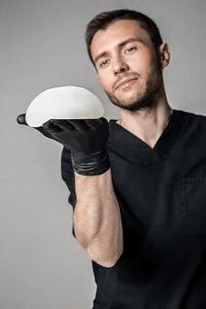 man holding implants